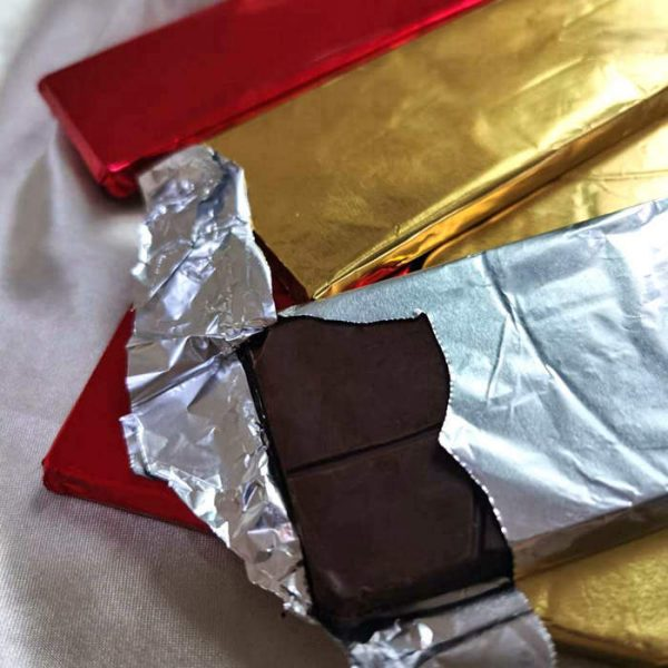 Chocolate bar wrapped by foil without paper wrapper