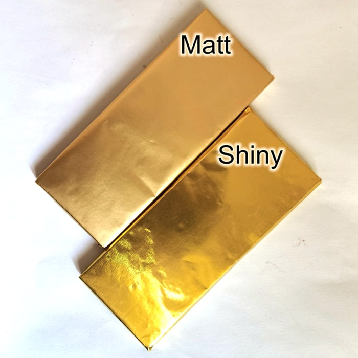 Chocolate bar wrapped by shiny foil and matt foil